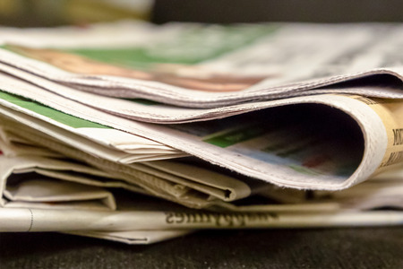 newspaper edge stack of paper editions news gossip source of information morning tradition breakfast fresh coffee page spacing