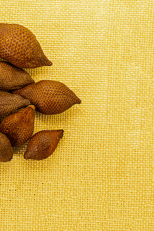 set of whole fruits snake fruit salacca spiny uneven skin exotic fruit of indonesia asia on a yellow background Archivio Fotografico