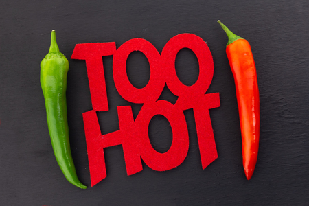 inscription Too Hot hot chili pepper message poster parallel chili pod red green frame on black form bright message 版權商用圖片