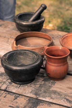 laboratory ancient herbalist mortar ceramic black bowl jug clay set of inventory Banco de Imagens