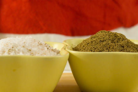 salt sea large granules ground coriander brown powder seasoning in green ceramic bowls macro design