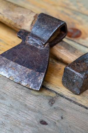 black sharp ax close-up on background  hammer big heavy on wooden boards design tool