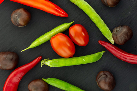 background vegetable pod pepper green peas vintage autumn farmer cherry tomatoes close-up on a black background