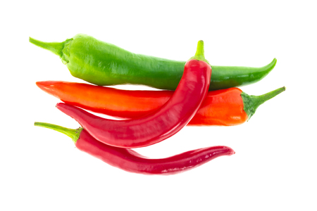 group of vegetables hot pepper red green pod on white background lots of bright base design