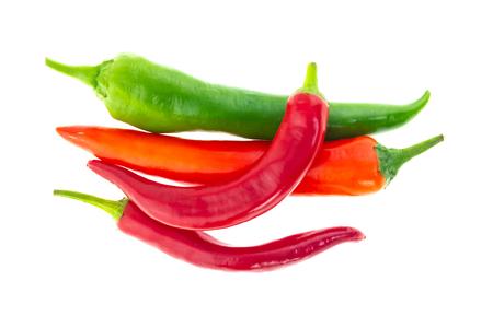 grupa warzyw ostra papryka czerwona zielona strąk na białym tle dużo jasnego wzoru podstawy Zdjęcie Seryjne