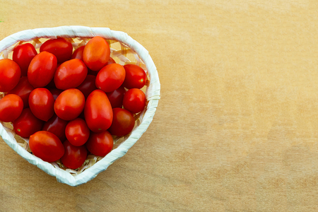 red mini tomato vegetables many fruits in a basket heart shape copy space culinary design