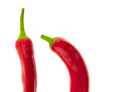 chili pepper red part of a pod straight curved on a white background design culinary base