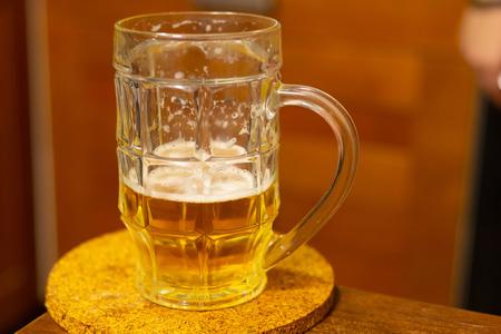 beer golden hop drunk half glass white foam close-up pub a refreshing drink Reklamní fotografie