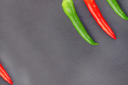 pod pepper green red corner design three chili slanted web based menu design on a dark background Banco de Imagens