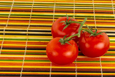 three tomatoes red ripe delicious on a green branch fresh vegetables base salad source of vitamins