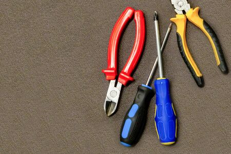 group of tools for repair. side cutters screwdriver and Phillips screwdriver copy space