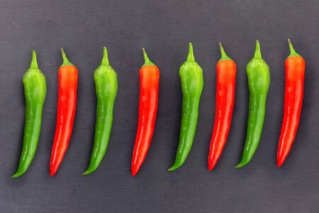 parallel green red chilli peppers consecutive repeating contrasting vegetable background