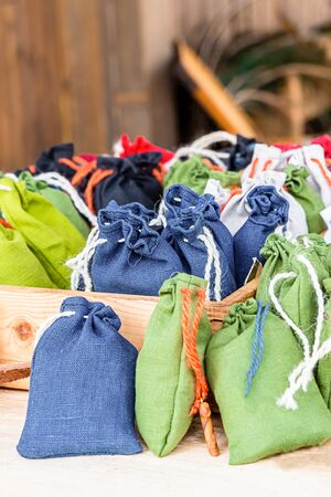 stall herbalist collecting plants sachet natural jute bag blue green white lots background