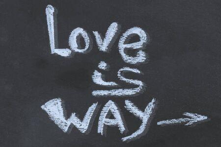 chalk message love is way on a dark background arrow basis design basis craft 版權商用圖片