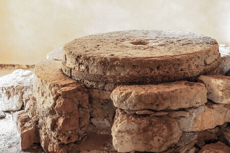 traditional mill for millet flour is made of heavy round stones