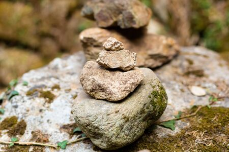 towers made of stone mini jagged stands on a rock close-up