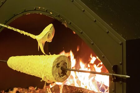 cooking traditional cake shakotis christmas treat. Elongated spinning traditional shape dough ladle fire fair