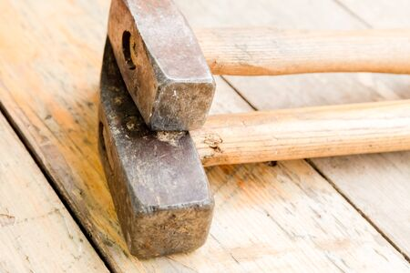 construction tools pair of heavy old hammers metal head on wooden background Stok Fotoğraf