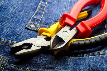 pair cutting pliers hand tools electrician building closeup red yellow handle Stok Fotoğraf