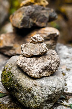 sunny day stone tower old mossy stone from big small on a blurred background mountains zen rest trekking