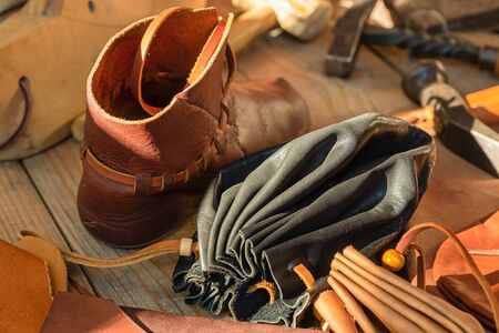 handmade leather goods tanner boots shoes traditional bag purse 스톡 콘텐츠