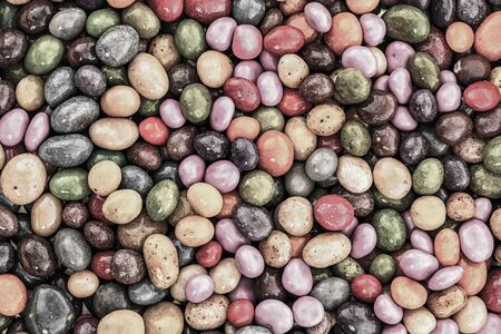 tinted dark background base glazed jelly beans candy yellow frosted lilac 스톡 콘텐츠