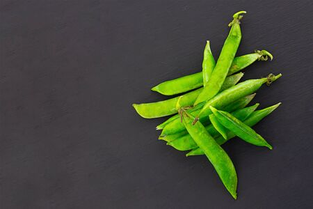 set green pod a bunch of vegetables black background design culinary