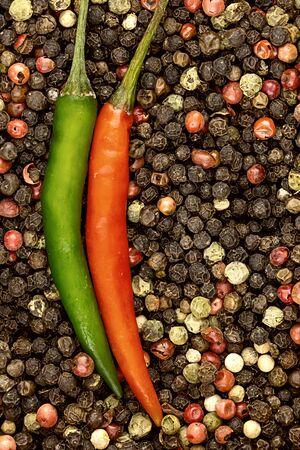 pepper set vertical parallel red green peppercorns white black background base