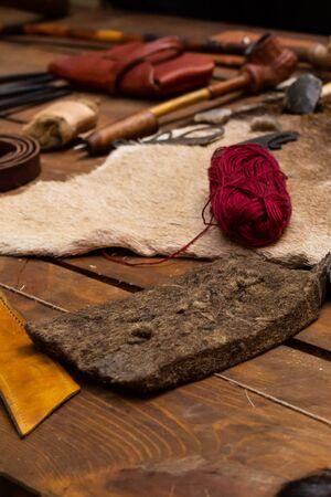 set desktop tanner wild animal deer fur yarn beaver tail against background tools 스톡 콘텐츠