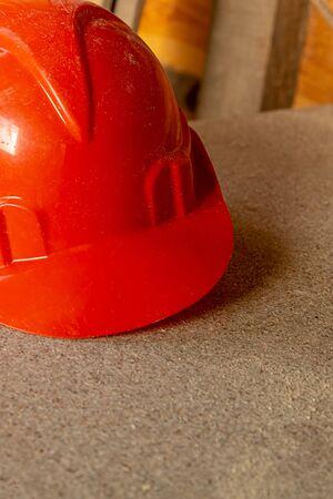 vertical photo bright orange helmet part of the building construction copy space