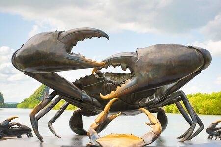 Krabi province Thailand august 2018. Statue of a crab big claws black metal small close up against the sky