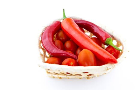 Spicy red set of vegetables tomatoes pepper basket white background
