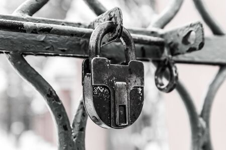 gray tinted lock padlock protection of the territory of the old weathered close-up