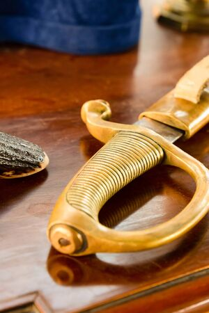 ribbed iron saber handle close up against the background of the desk of a military officer 스톡 콘텐츠
