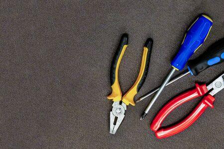 background basis set nippers pair screwdriver repair of electrical engineering