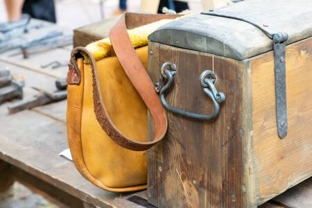 wooden old box weathered wrought iron handles leather bag yellow set travel medieval baggage