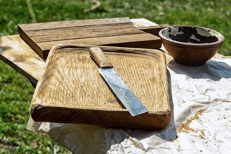 outdoor kitchen plank wooden large solid wood large knife clay pot