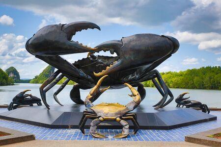 Thailand Krabi Island July 2018. Statue crab black metal symbol city Krabi background spilling river