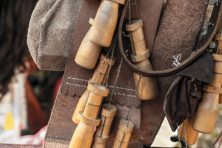 background ammunition hunter leather belt and storage wooden flask of gunpowder close-up