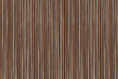 wooden pattern with parallel vertical lines ribbed background dark brown