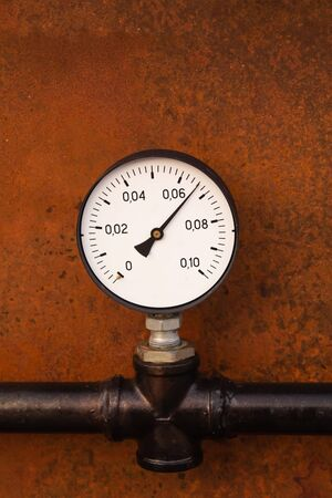 pressure adjustment close-up on a background of rusty iron engineering Stock Photo