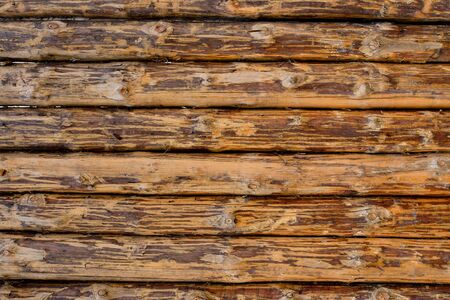 wooden background from old and weathered planks of beige and brown horizontal pattern