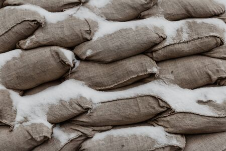 sandbag gray old and weathered protective wall against the storm closeup 免版税图像