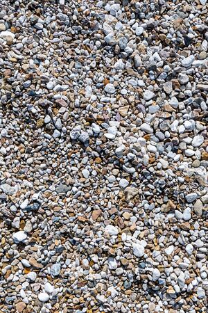 gray gravel stone road background vertical closeup with wave effect