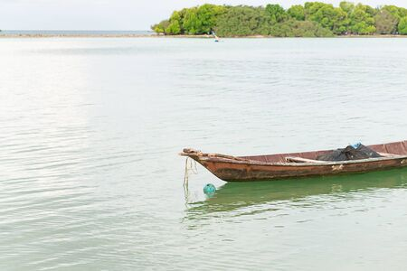 long iron boat rusty and old traditional transport asia on a wide river background Stok Fotoğraf
