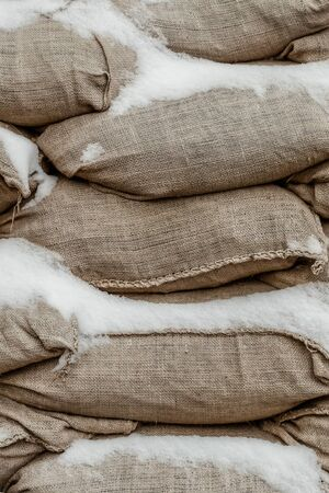 sand bag hurricane and flood protection closeup background base