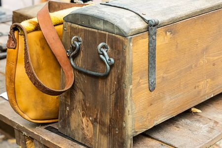 old wooden chest close-up used as a camping safe and a bag for storing documents Archivio Fotografico