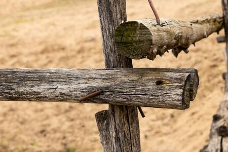 old wooden beam stacked in a fence weathering pasture protection 版權商用圖片