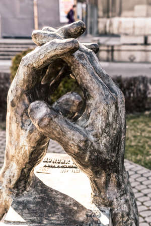 Serbia Subotica March 2019. Hands entwined bronze statue in memory of Frenz Sepa priest protector