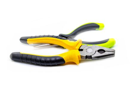 yellow pliers pair of hand tools bright white background repair construction